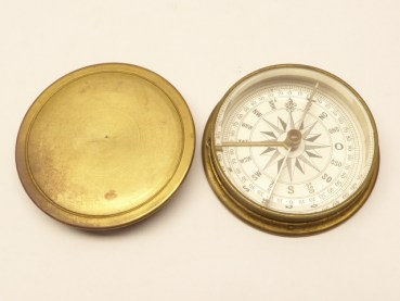 Old compass with cover