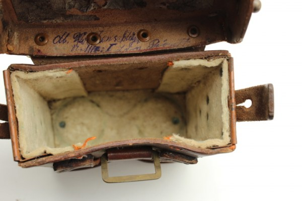 "WW1 World War I - Binoculars 08 - ""Emil Busch A.G. Rathenow"" 1915 with a round leather strap in a belt pocket"