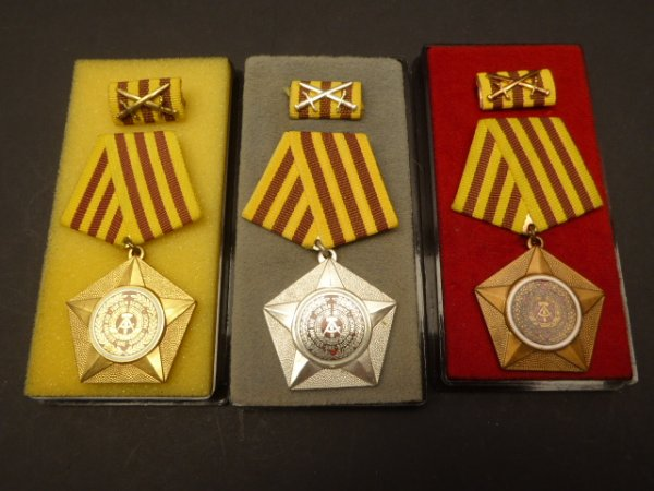 "DDR NVA Kampforden ""For services to people and fatherland"" 1st model in gold + silver + bronze"