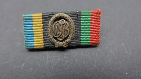 German sports badge in bronze as a ribbon buckle badge