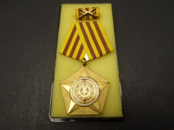 "GDR NVA Kampforden ""For services to people and fatherland"" 1st model in gold (900 silver gold-plated)"